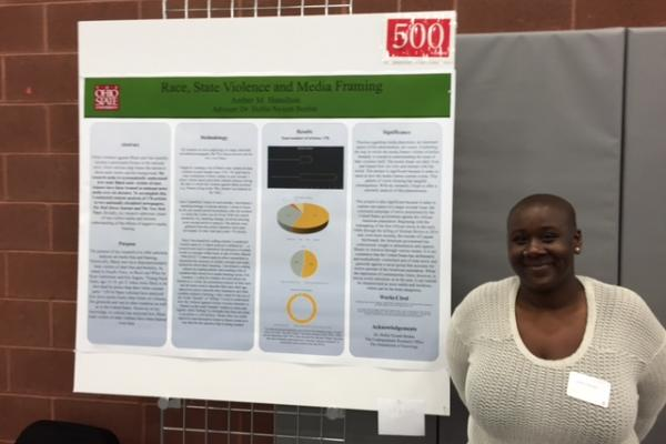 Photo of Ms. Hamilton with her research presentation