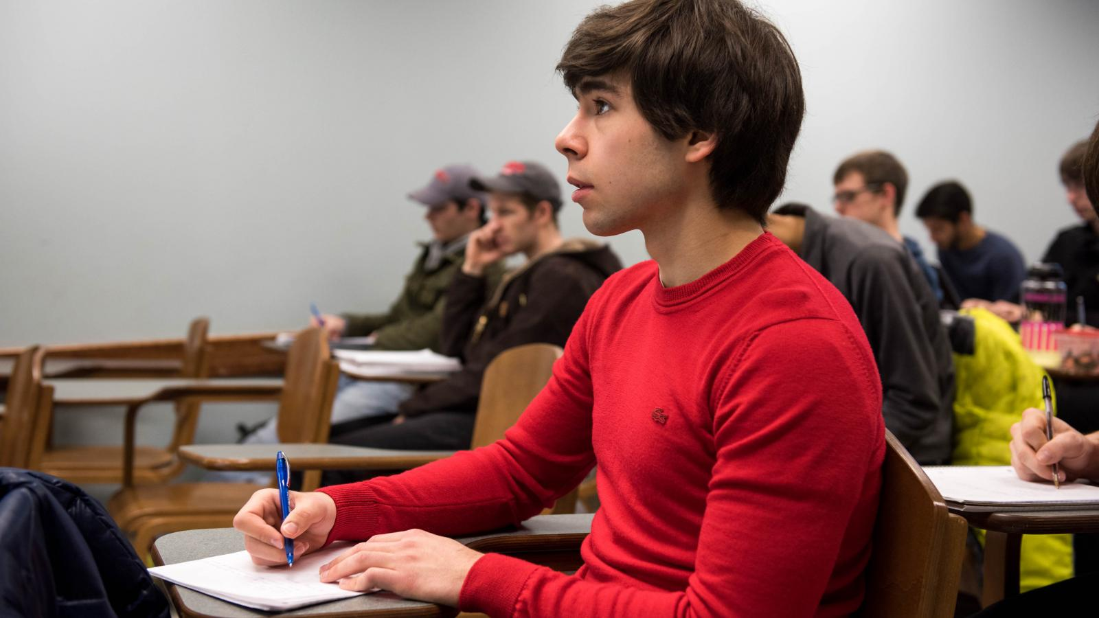 Young man taking notes