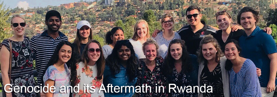 Group of students, smiling at camera, Rwandan city sky line in the background